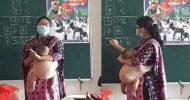 সন্তান কোলে নিয়েই শিক্ষার্থীদের পড়াচ্ছেন মা, মনে দাগ কেটেছে নেটিজেনদের